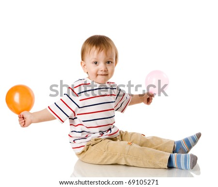 Little Boy playing with balloon isolated on white