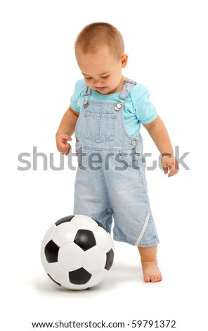 Little boy playing with black and white leather football ball - stock photo