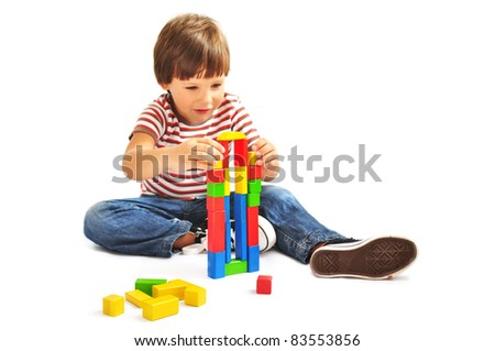 Little boy playing with building blocks, isolated - stock photo