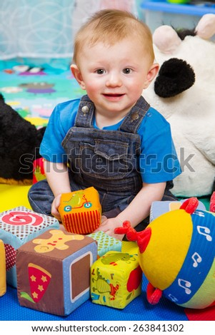 little boy playing with colored soft cube - stock photo