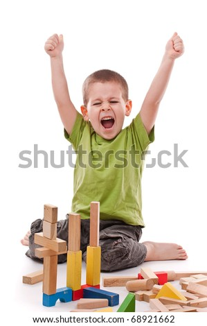 little boy playing with colorful blocks, isolated on white background - stock photo