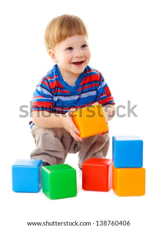 Little boy playing with colorful cubes, isolated on white - stock photo