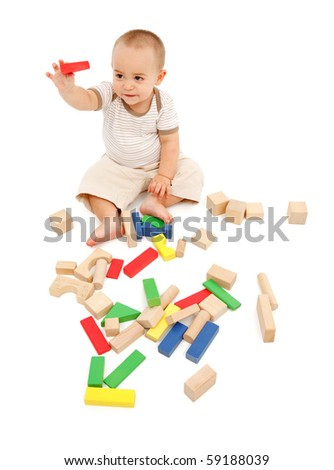 Little boy playing with colorful, wooden blocks - stock photo