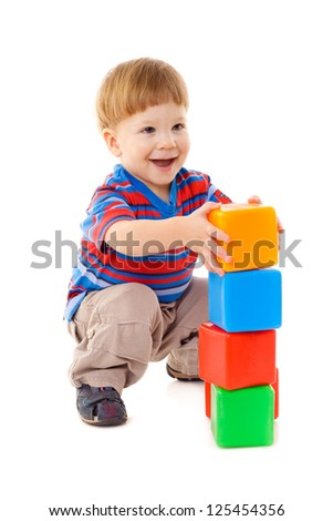 Little boy playing with cubes, isolated on white - stock photo