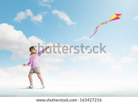 Little boy playing with kite. Childhood concept