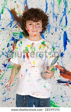 Little boy playing with painting on the background painted - stock photo