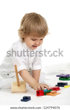 little boy playing with pyramid