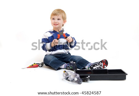 little boy playing with tools isolated on white