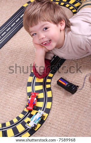 little boy playing with toy car - stock photo