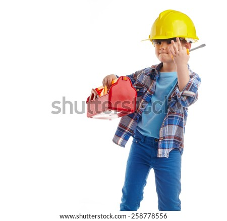 Little boy plays construction worker. Isolated on white - stock photo