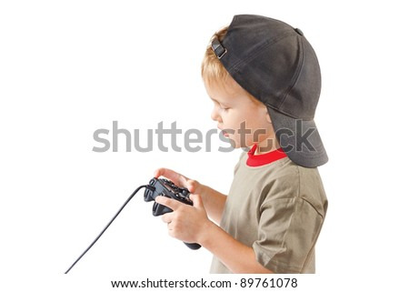 Little boy plays with a joystick on a white background