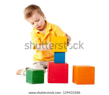 little boy plays with cubes - stock photo
