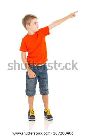 little boy pointing empty copy space - stock photo