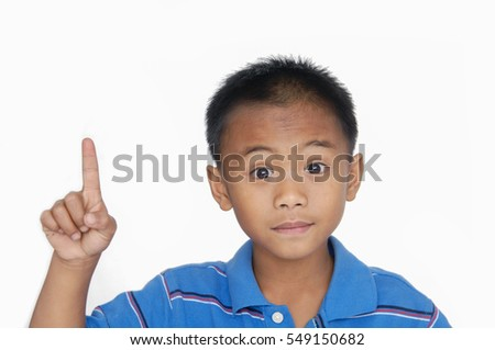 little boy pointing upward