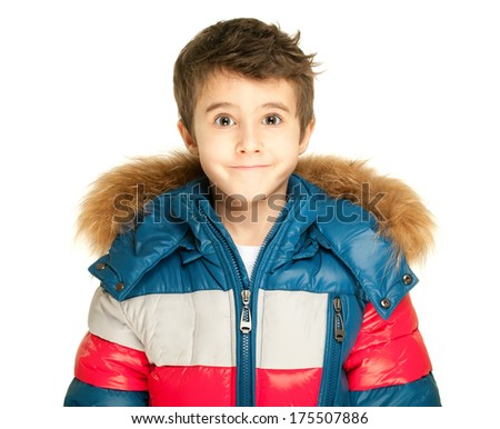 Little boy portrait in winter jacket isolated on white - stock photo