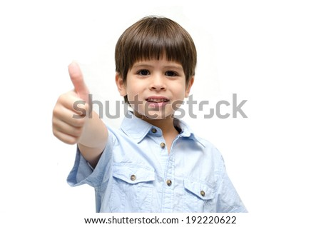 Little boy portrait with thump up on white background - stock photo