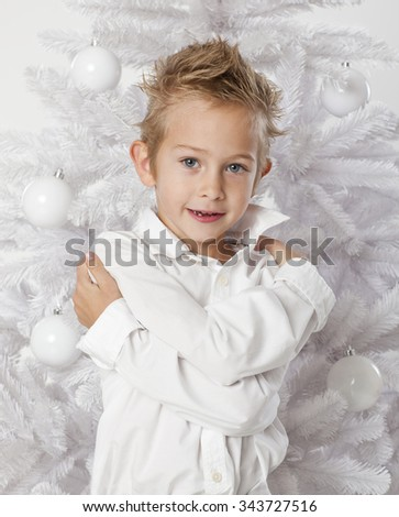 Little  boy portrait  with white decorated Christmas trees