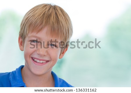 Little boy posing in the park at bright summer day