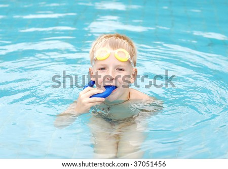 little boy practice snorkeling in the swimming pool - stock photo
