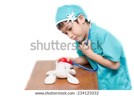 Little boy pretend as a doctor - stock photo
