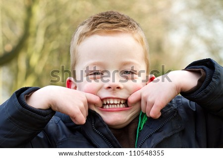 little boy pulling a happy funny face