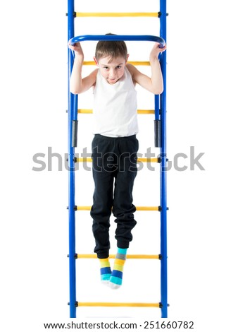 Little boy pulls up on the sports Horizontal bars ON A WHITE BACKGROUND - stock photo