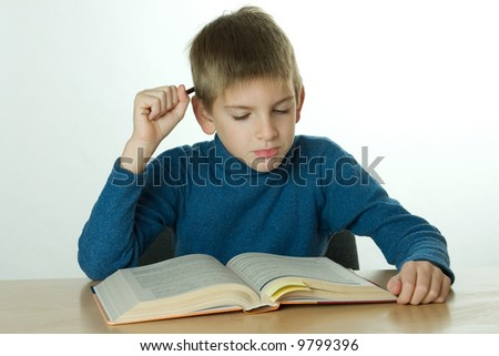 little boy read book and scratch one's head