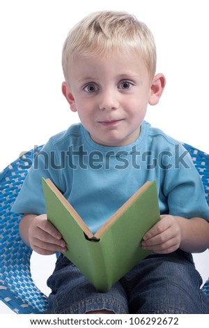 little boy reading a book. Isolated on white background - stock photo