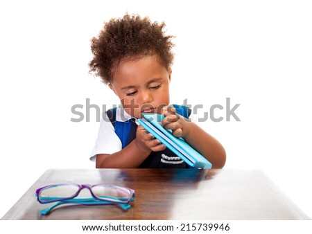 Little boy reading books, portrait of sweet African American kid isolated on white background, preparation to go to first grade, back to school concept - stock photo