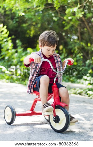 Little boy riding a bicycle - stock photo