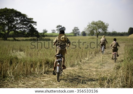 Little boy scouts Cycling center field - stock photo