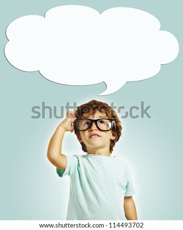 little boy scratching his head thinking with copy space - stock photo