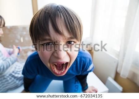 little boy screaming stock photo edit now 672034135 shutterstock
