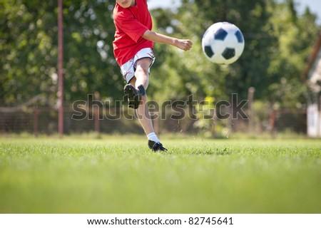 Little Boy Shooting at Goal - stock photo