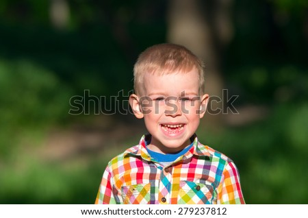 Little boy shouts of joy and face contorts. Family composition - stock photo