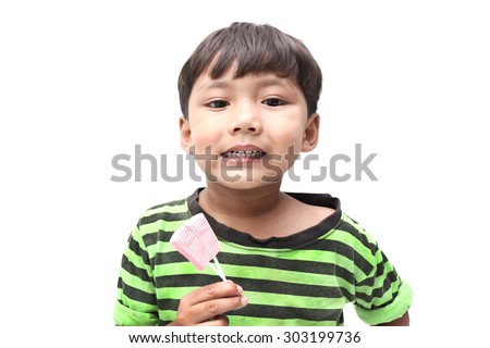 Little boy show his beautiful teeth with candy isolated on white background.