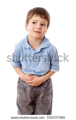 Little boy showing stomach pain, isolated on white - stock photo