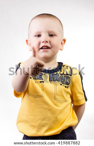 Little boy showing thumbs up