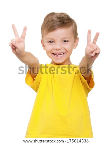 Little boy showing victory hand sign on white background