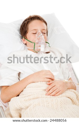Little boy sick in the hospital, breathing with the help of a respirator. - stock photo