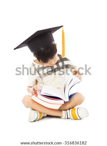 little boy sitting and reading a book - stock photo