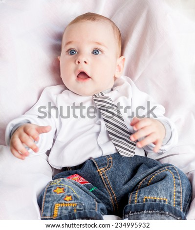 Little boy sitting in car seat - stock photo