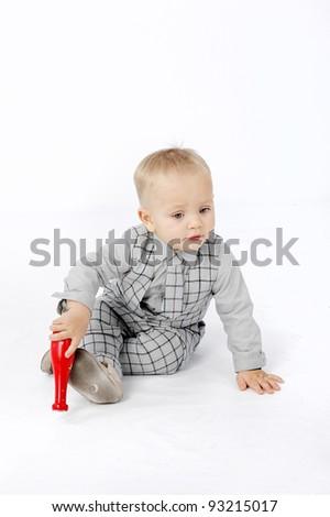 Little boy sitting on the floor - stock photo