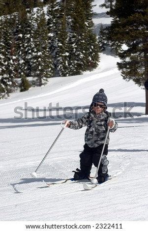 Little Boy Skiing Downhill - stock photo
