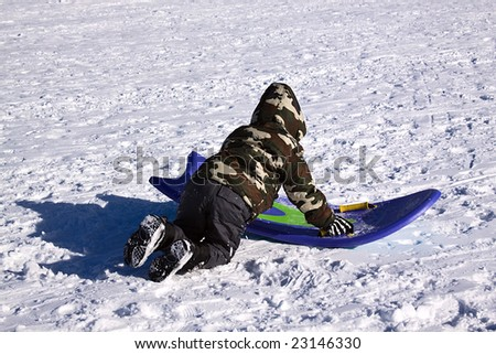 Little Boy Sledding down the Hill - Winter Scenes