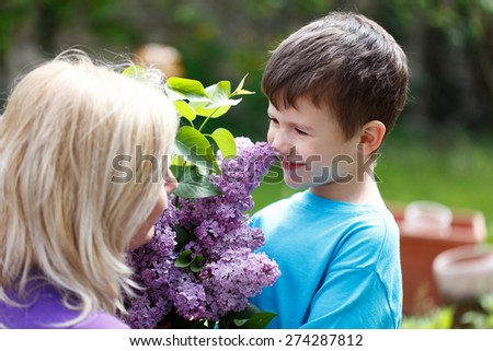Little boy smell lilac, mother's day - stock photo