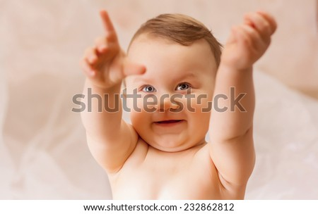 little boy smiling and stretching his arms - stock photo