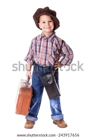 Little boy standing with old suitcase, isolated on white - stock photo