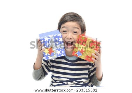 Little boy surprise with gift box on white background - stock photo