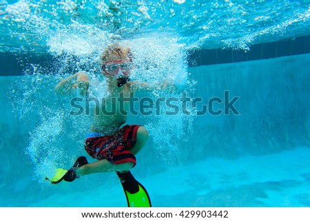 little boy swimming underwater - stock photo
